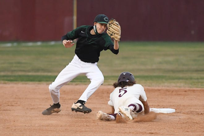 Bastrop's Austin Tabola slides safely into second in the Bears' 9-2 win over Connally Tuesday.