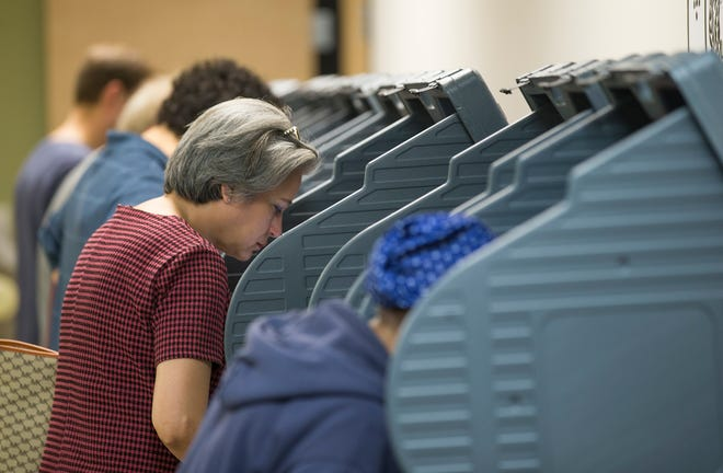 Voters are shown completing their ballots during a 2018 election. Half of the Austin City Council races since 2014 have been decided in low-turnout December runoffs.