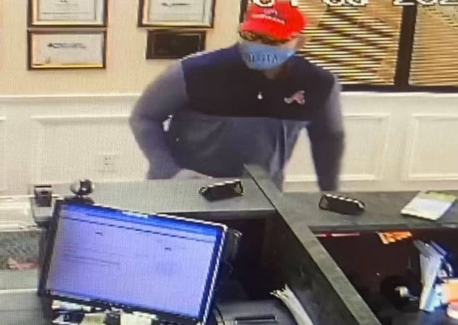 This man is shown robbing a credit union office in Jefferson on Tuesday.