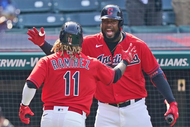 Cleveland's Franmil Reyes, right, congratulates teammate Jose Ramirez after Ramirez hit a two-run home run in the eighth inning of a baseball game against the Kansas City Royals, Wednesday, April 7, 2021, in Cleveland. Cleveland won 4-2. [Tony Dejak/Associated Press]