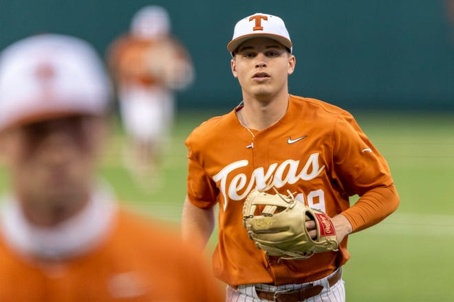 Texas' Mitchell Daly heads for the dugout after getting the third out against Texas A&M-Corpus Christi in the third inning of the Longhorns' 14-4 win Tuesday night at UFCU Disch-Falk Field.