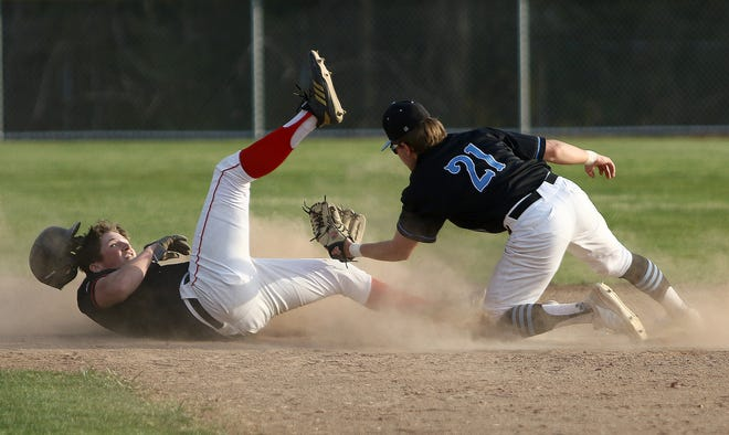 Salem's Gavin Wilms, left, was safe at second base after the throw to Alliance's Eric Bennett during action at Alliance High School on Tuesday, April 6, 2021.