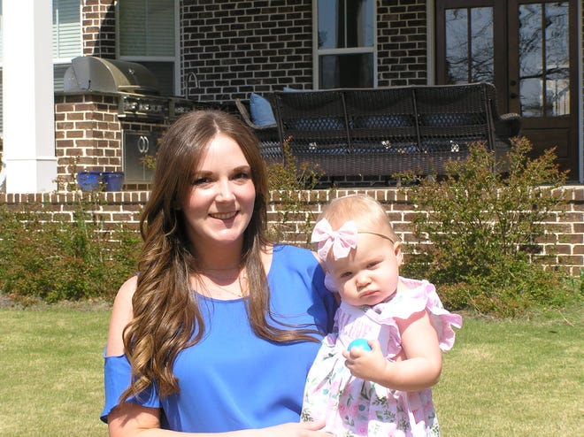Pediatric nurse practitioner Krystal Oestreich holds her daughter, Adaline, 15 months, in their backyard in North Augusta. Oestreich likely passed on a powerful antiviral and potent antibodies to COVID-19 to her daughter through her breast milk, studies suggested.