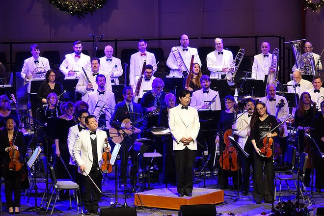 Cape Cod Symphony Orchestra members and Artistic Director Jung-Ho Pak take a bow at the 2017 holiday concert in Hyannis.