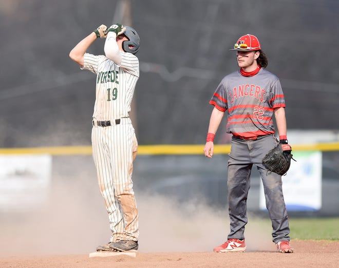 Riverside's Evan Burry reacts after getting a double as Neshannock's Michael Altmyer stands at second during Tuesday's game against at Riverside. Riverside defeated the Lancers 4-1.