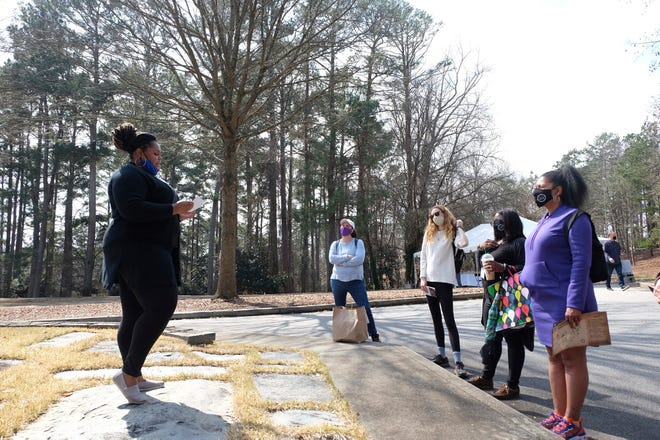 Marisa Davis, a graduate student at Clemson University, talks to a group touring Woodland Cemetery on campus in Clemson on Feb. 28. Students and other university affiliates plan to hold regular tours about the cemetery's history after hundreds of previously unmarked graves likely belonging to African Americans were identified last year.