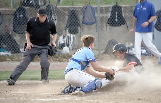 Boonville catcher Kayle Rice applies the tag on Southern Boone's Cade Schupp in the fifth inning Monday night in Tri-County Conference action at Twillman field in Harley park. Rice had the tag down in plenty of time for the out. However, after a conference meeting with the infield umpire, Schupp was ruled safe after declaring that Rice had blocked the plate. SBC went on to win the game 9-0.