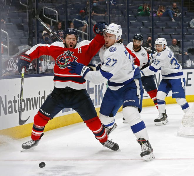 Blue Jackets center Boone Jenner, left, and Lightning defenseman Ryan McDonagh fight for the puck in a game at Nationwide Arena on Tuesday.
