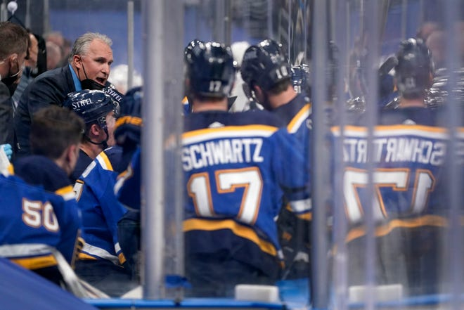 St. Louis Blues head coach Craig Berube, left, talks with his team during a game against the Vegas Golden Knights on Monday in St. Louis.