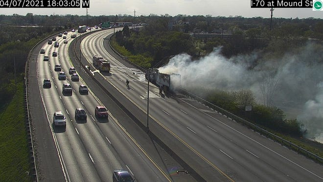 The westbound lanes of Interstate 70 near Downtown are closed as crews fight a tractor-trailer fire.