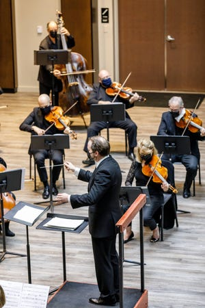 ProMusica Music Director David Danzmayr conducting members of the orchestra at The Fives during a performance last autumn.