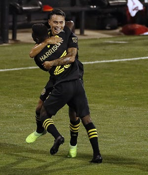 Midfielder Lucas Zelarayan and defender Harrison Afful, here celebrating after Zelarayan's goal against Philadelphia on Sept. 2, are hoping to help the Crew become the first team from Major League Soccer to advance to the FIFA Club World Cupby winning CONCACAF Champions League.