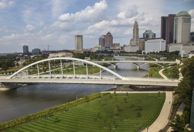 In this file photo, the downtown Columbus skyline and Scioto Mile is seen beyond the Rich and Town street bridges over the Scioto River from Miranova Tower.