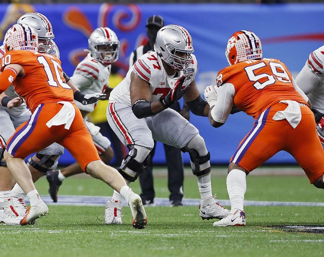 Ohio State's Paris Johnson Jr., here blocking Clemson's Jordan Williams, filled in at guard during the College Football Playoff when Wyatt Davis missed time with a knee injury. That experience is expected to help him this season as he steps full-time into Davis' right guard spot.