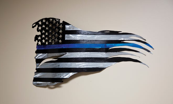 """A """"thin blue line"""" flag at the FOP Capital City Lodge 9 office"""