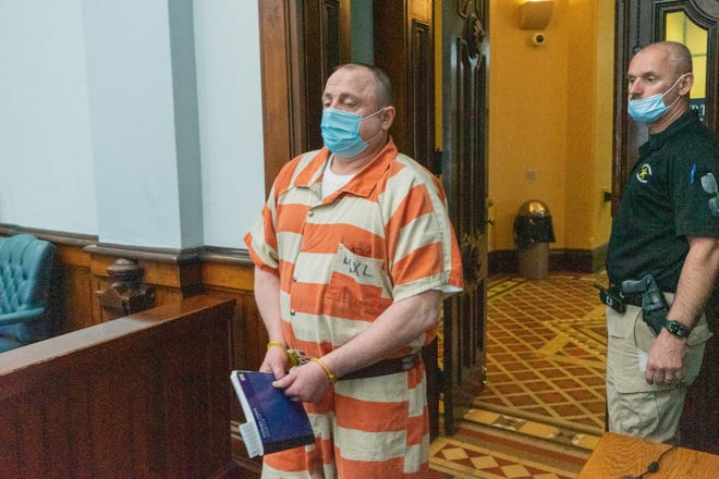 Ronald Wolters, of Buffalo, enters the courtroom for his sentencing on Wednesday. Wolfters was previously found guilty on three counts of rape and eight counts of gross sexual imposition. He was sentenced to three consecutive life terms in prison with the possibility of parole after 75 years.