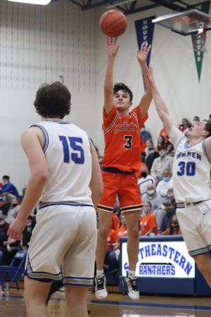 Meadowbrook junior sharpshooter Jake Singleton (3) lets loose with a deadly three-pointer during Division II regional semi-final action against Warren High at Southeastern High School. Singleton was named to the Division II All-Ohio First Team on Tuesday.