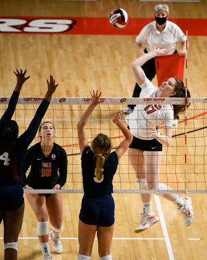 Western Kentucky Hilltoppers middle hitter Sam Canner (17) in action versus FIU Panthers at E.A. Diddle Arena in Bowling Green, KY