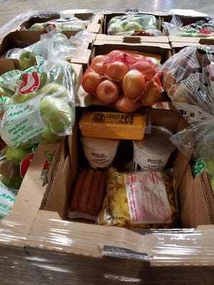 Boxes of food for a giveaway organized by Hope and Encouragement for Humanity are pictured.