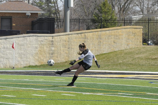 Adrian College's Kristen Page boots the ball away during Tuesday's match against Hope.