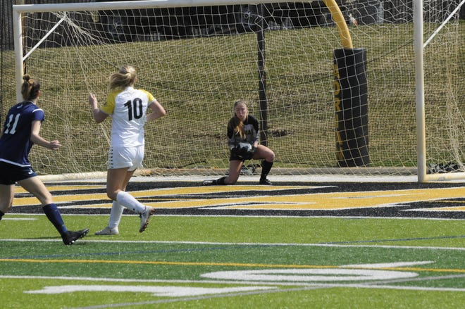Adrian College's Kristen Page makes a save during Tuesday's match against Hope.