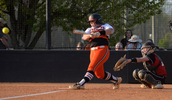 North Davidson's Alex Gray hits a run-scoring single against Central Davidson. [Mike Duprez/The Dispatch]