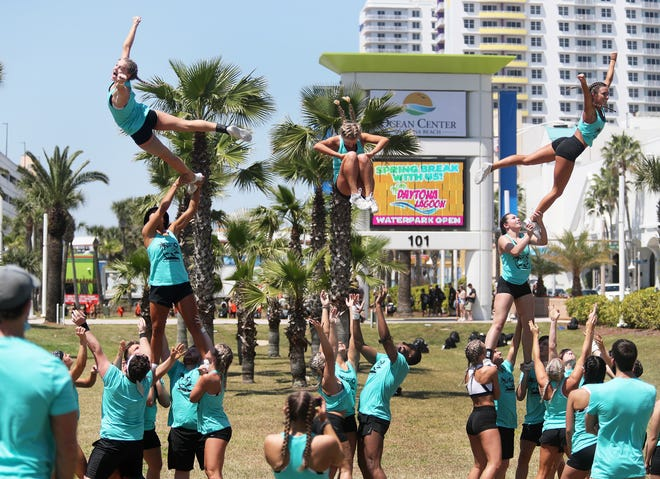A cheerleader squad practices on the lawn outside the Ocean Center this week, as part of the College Cheer and Dance National Championship sponsored by the National Cheerleaders Association and the National Dance Alliance. Thousands of students on cheerleading teams and dance units representing roughly 140 colleges and universities nationwide are in Daytona Beach for the five-day event that runs through Sunday.