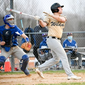 Western Wayne's Mike Kromko takes a big rip during Lackawanna League varsity baseball action Monday afternoon at Mid Valley. The senior outfielder helped his Wildcats post a tnrilling 6-5 decision ober the Spartans.