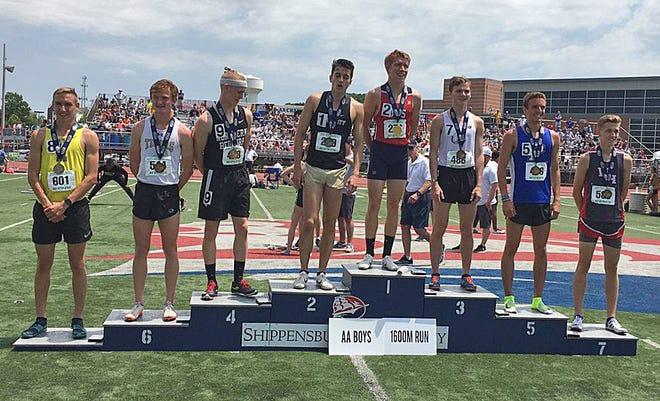 The top eight finishers from the PIAA Class 2A boys 1,600-meter run stand on the medal podium on May 25, 2019, during the PIAA championships at Seth Grove Stadium at Shippensburg University. For the first time since 2019, the PIAA championships will take place May 28-29 in Shippensburg.