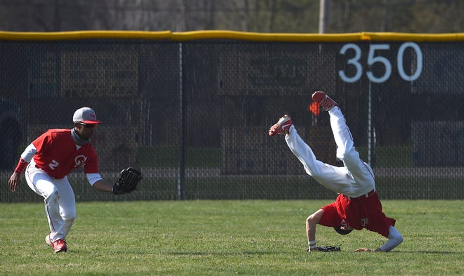 General McLane centerfielder Jaxon Scrutchins, left, catches a shallow fly ball, as shortstop Matt Leehan, right, leaps to avoid a collision in a Region 5 game against McDowell on Wednesday at General McLane High School.