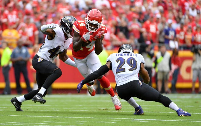 Chiefs wide receiver Sammy Watkins (14) tries to elude Baltimore Ravens defenders Marlon Humphrey (44) and Earl Thomas (29) in a game at Arrowhead Stadium. Watkins, after not being signed by the Chiefs, found the Ravens to be a perfect fit for his skills.