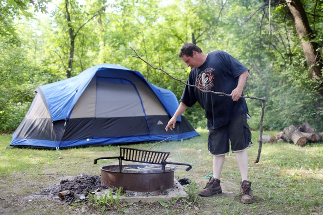 In this file photo Shaun Scott, Danville, builds a fire while camping at the Geode State Park campgrounds.