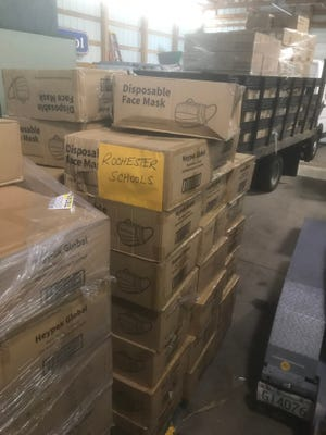 The Rochester school district received a donation of 126,000 disposable face  masks from the Wal-Mart Distribution Center in Raymond on Friday, April 2.