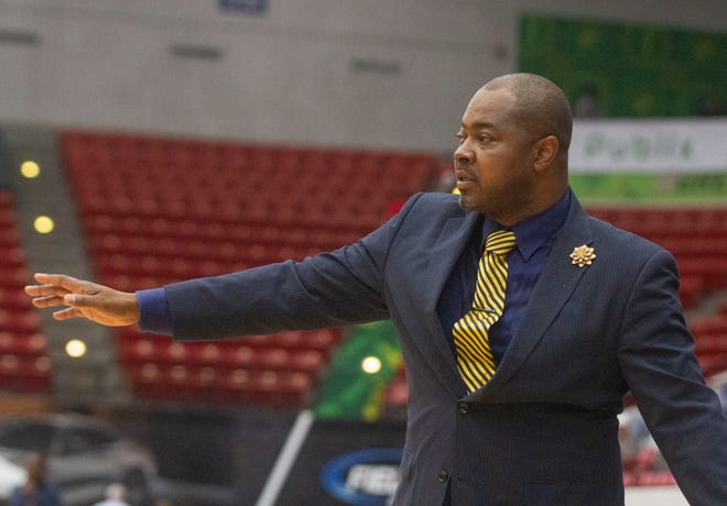 Paxon head basketball coach Toby Frazier instructs his players against Stranahan during the 2020 FHSAA final four.