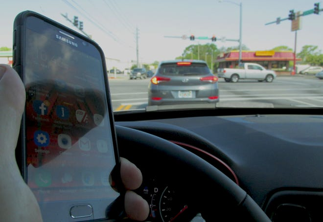 Safety experts remind drivers not to text and drive as police locally and nationwide increase enforcement during Distracted Driving Awareness Month. This image was taken at a stop light.