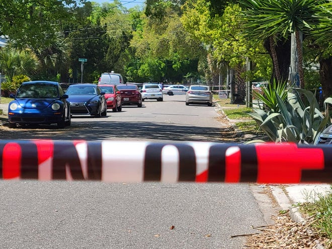Jacksonville police cordon off West 23rd Street for a homicide investigation Wednesday.