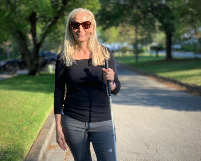 Alison Miller, who has lost most of her eyesight as an adult, took Times-Union columnist Mark Woods on a walk through her Avondale neighborhood.