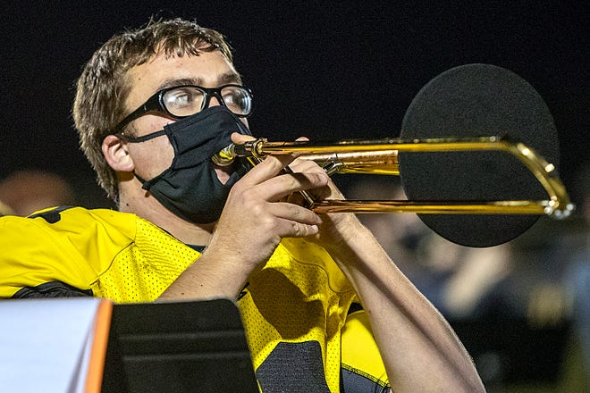 Galesburg High School senior Ben Rohn plays his trombone during halftime of the Silver Streaks' football game against Quincy on Friday, March 26, 2021 at Van Dyke Field.