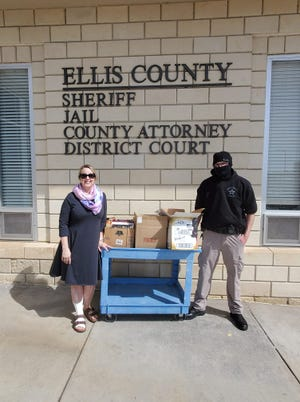 Broman Miller drops off books at the Ellis County Jail.