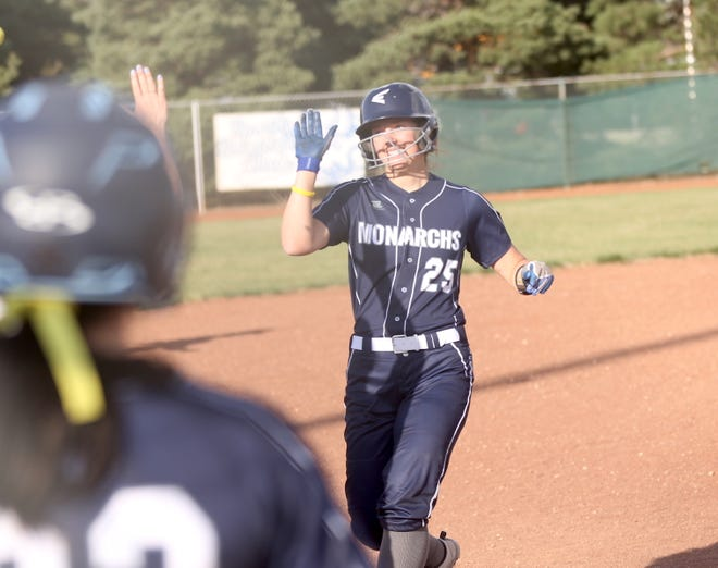 TMP-Marian's Jessica Herrman is congratulated by teammates after Herrman laid down a key bunt that helped the Monarchs take a walkoff 4-3 win in Game 1 on Tuesday against Colby.