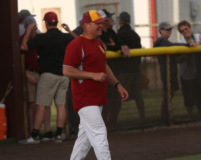 Hays High baseball coach Dustin Dreher reacts after the Indians completed a doubleheader sweep of Washburn Rural on Tuesday at Hays High.