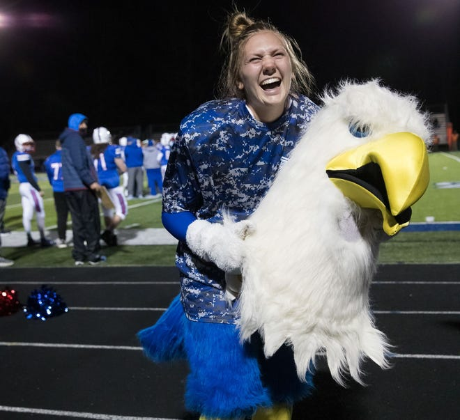 Margaret-Ann Littauer is revealed as the West Henderson Falcon during last week's game between West and Enka.