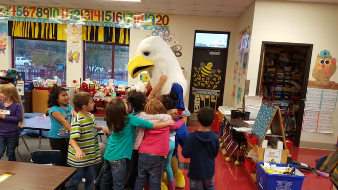 The Falcon, who was portrayed by Rebekah Littauer in this 2018 photo, visits Mills River Elementary School.