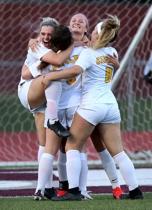 Circle players congratulate Carsyn Soto (11) after she scored a goal against Buhler Tuesday evening.