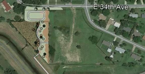 This is an aerial view of the proposed Woodland Park edition, which will include 12 duplexes in the  open field marked here by the dark outline, with a proposed park in the lighter green west of the housing.