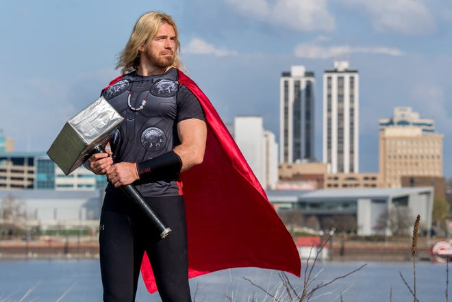 Chris McGovern, a Peoria biologist and avid runner, strikes a pose in his Thor costume. McGovern started wearing the outfit and adopting the persona of the Marvel Comics superhero as a member of the Peoria Hash House Harriers, a running group that holds charity running events, often while wearing costumes..