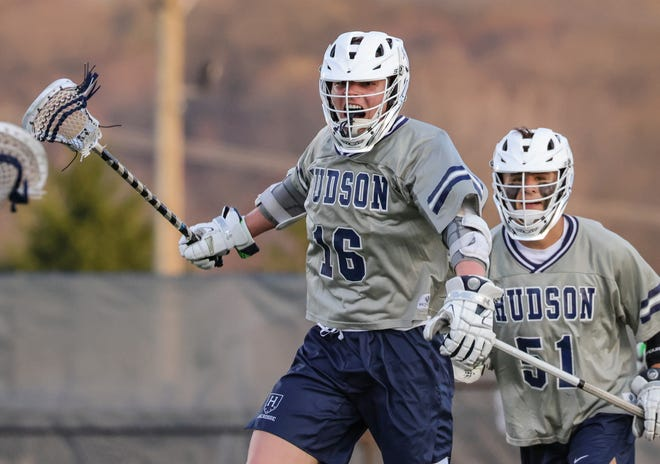 Hudson's Alec Dickens (16) celebrates a goal as Adam Oscarson (51)  looks on. The Explorers topped Chagrin Falls 13-5 Tuesday at home to improve to 3-0.
