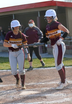 Walsh Jesuit pitcher Natalie Susa, right, celebrates with teammate Maddy Schmeiser after belting a two-run home run Tuesday at Stow-Munroe Falls.