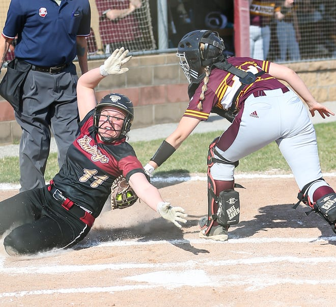 Walsh Jesuit catcher Mia DeSciscio tags out Stow-Munroe Falls' Rachel Edmonson at the play during the Warriors' 11-0 win at Stow this spring.