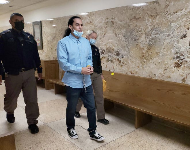 Phillip Velazquez, the third defendant in the Jan. 27, 2017 armed robbery at Picantes Restaurant, is escorted out of the 364th District Court on Wednesday after he was sentenced to 45 years in prison for his role in the robbery.